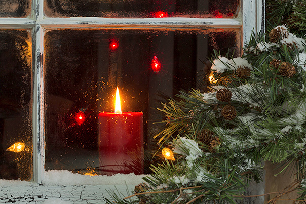 photo of red candle burning in window at Christmas