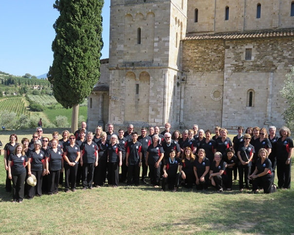 photo of choir in front of Abbazia di Sant'Antimo, Italy